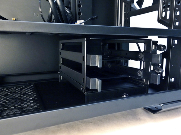 It's recommended to slide the 3.5-inch drive cage onto the mounting tray and secure the cage from within the chassis.