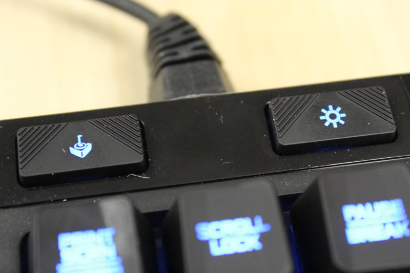 The left button controls whether the Windows shortcut key is enabled or not. The right button controls how bright the backlights are; there are a few settings to choose from.