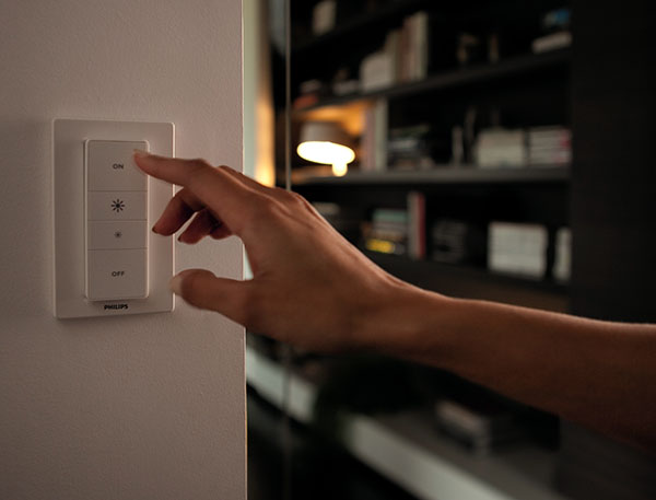 The dimming remote can be mounted onto a wall, or stuck on using the back adhesive.