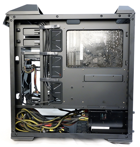 Looking at the amount of cables from the PSU, it might not be such a good idea to install drives behind it.