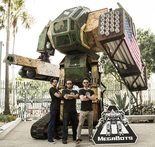 Megabot Mk. II, with its three co-founders from Megabot Inc.