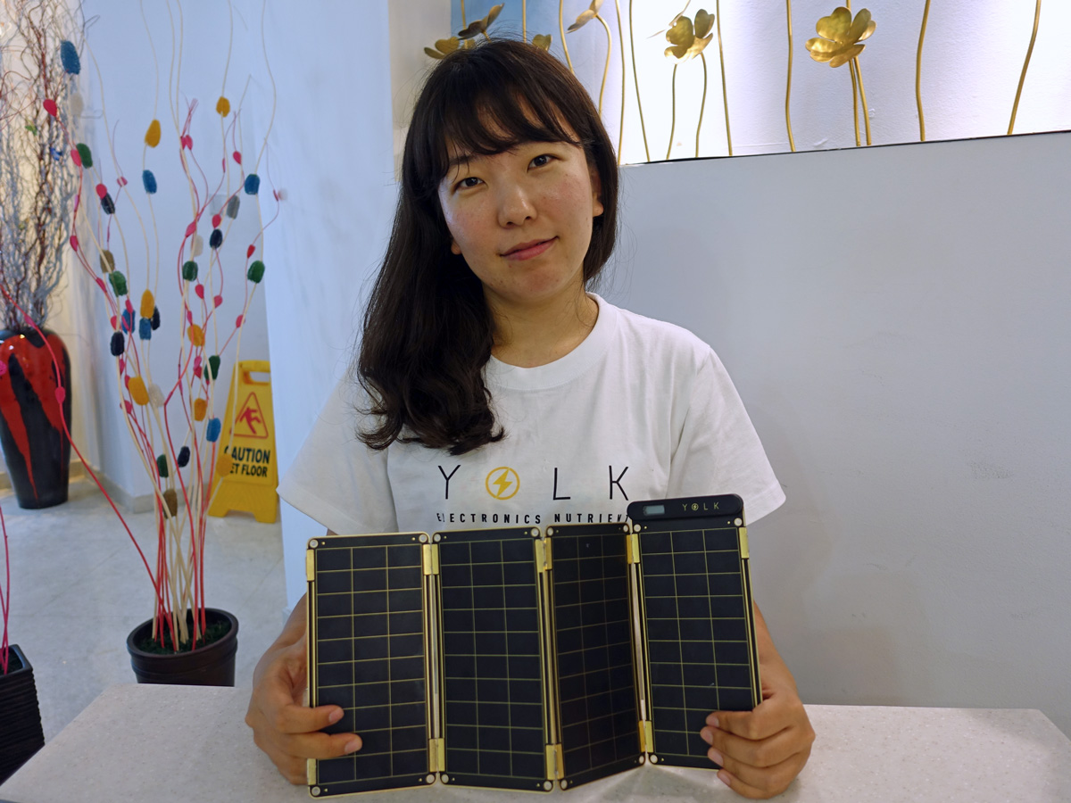 Sungun Chang, designer and CEO of her startup, Yolk, with the Solar Paper.