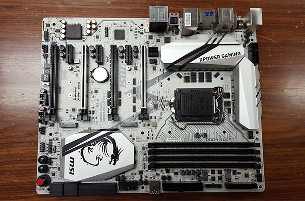 The entire PCB is colored a unique titanium-silver color. Do note the silver-colored first and third PCIe 3.0 slots, which have been reinforced with MSI's Steel Armor to hold up better under heavy GPUs.