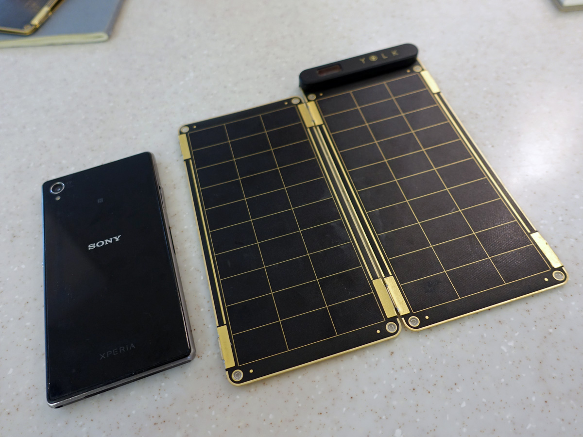 The Solar Paper (right) together with a 5.0-inch smartphone for size reference.