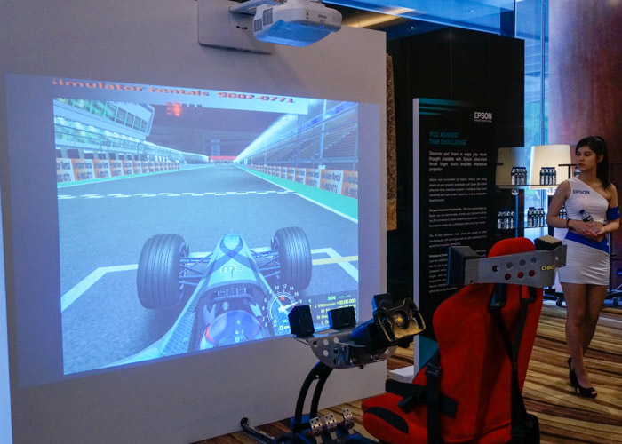 An Epson short-throw projector was used on a blank wall to form a massive screen for the racing simulator.
