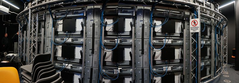 Around the back, this is what the CAVE2 infrastructure is made of – numerous screens and a 10Gbps high speed network fabric linking everything to processing nodes.