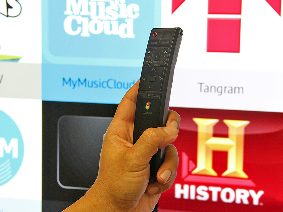 The new-look smart remote control is comfortable to hold. Lightly touch the Pointer button and move the remote to move the onscreen pointer.