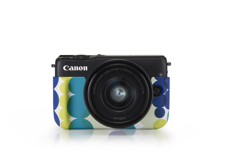 Canon EOS M10, in a jacket Canon terms as aqua.