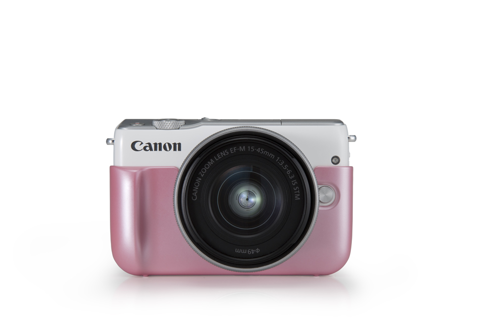 Canon EOS M10 in white, with pink jacket.