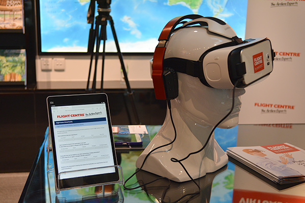 Flight Centre uses Samsung Gear VR Innovator Edition headsets for its VR experience. A digital feedback form on the tablet beside it encourages customers to leave feedback.