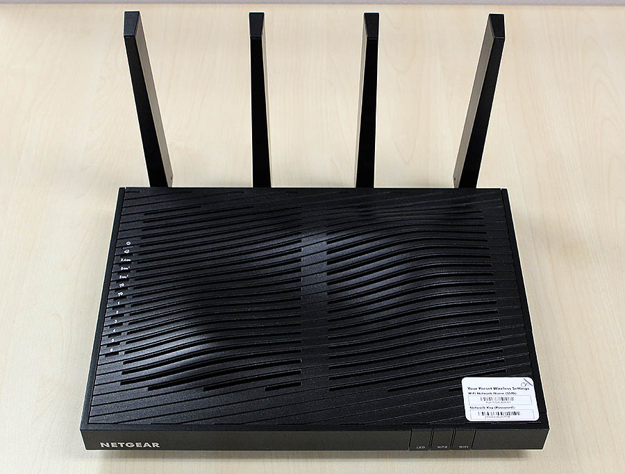 The Netgear Nighthawk X8 is the largest router we have encountered and looks like a Blu-ray player with antennas.