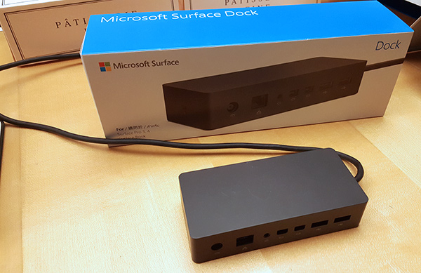 The new docking station is no bigger than a large power brick.