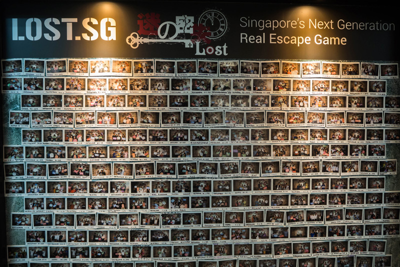One of the many, many walls adorned with pictures of those who've attempted the rooms.