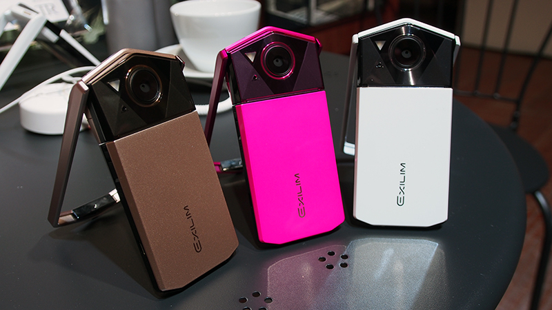 Casio EXILIM EX-TR70 in Gold, Pink, and White.