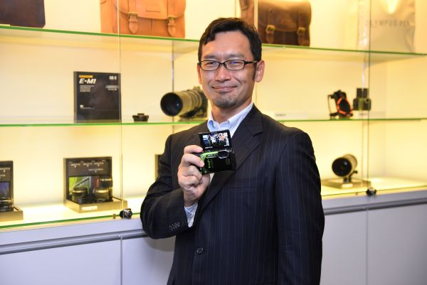 Mitsuhiro Tanaka, Manager, Imaging Business Division, Southeast Asia and Oceania, Olympus, with the TG-870 at a preview event last year.