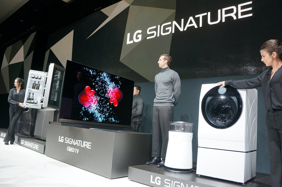 The complete range of LG Signature equipment - a 4K HDR OLED TV, a refrigerator, a washing machine and an air purifier.
