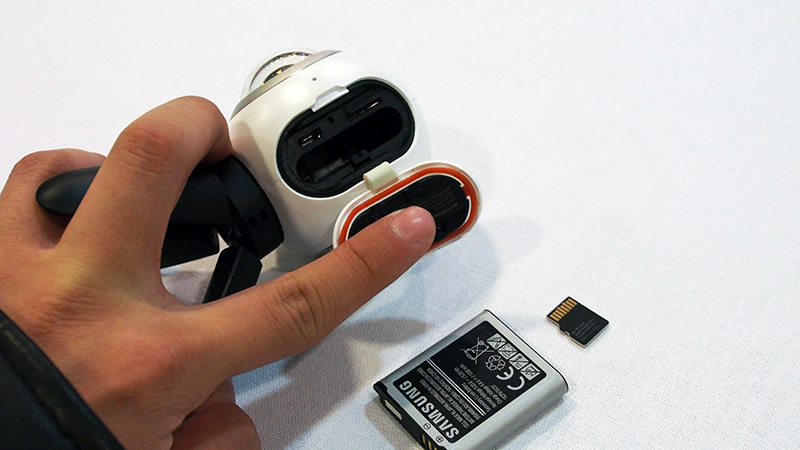 The Samsung Gear 360 can take MicroSD cards with up to 128GB storage. It uses removable Li-ion batteries. The third opening is a Micro-USB port.