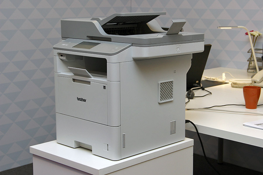 The MFC-L6900DW prints up to 50ppm, is wireless and network enabled, and has a 4.85-inch touchscreen, a dual-CIS ADF, and an NFC card reader.