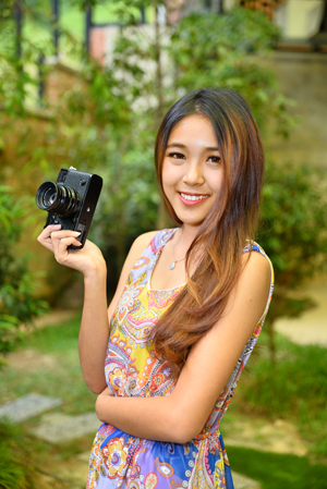 Here We Have A Model Holding The FUJIFILM X Pro2