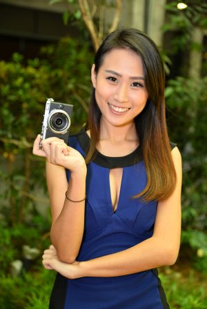 And Over Here We Have A Model Posing With The FUJIFILM X70
