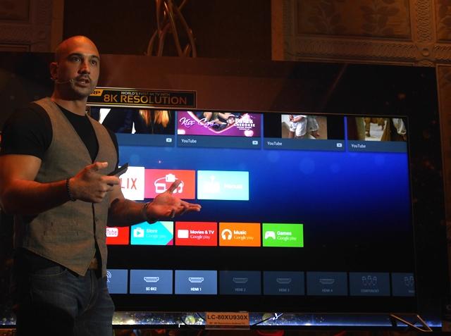 The 80-inch Sharp AQUOS XU 4K TV with KC Montero.