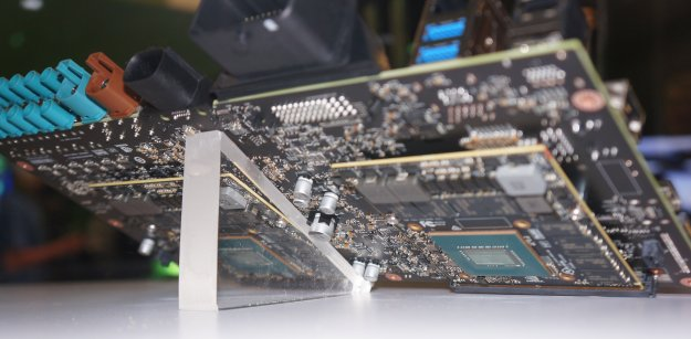 On the rear side of the board, you can catch a glimpse of the two discrete Pascal GPUs used to augment the Tegras on the front.