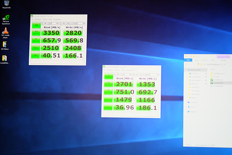 Here's a look at the CrystalDiskMark scores with three Intel 750 series SSDs in RAID 0 (top left).