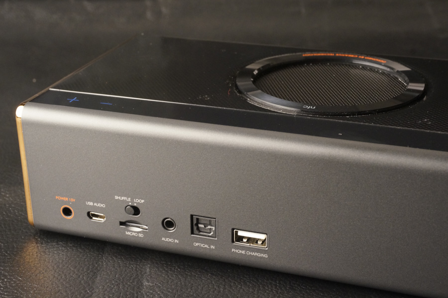 All the needed ports are on the spine of the speaker.