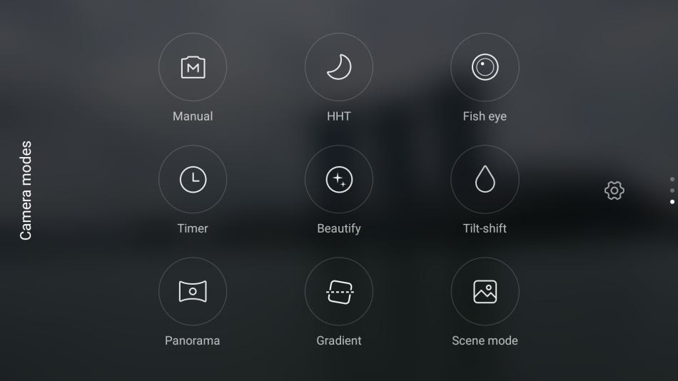 Swipe up from the bottom of the screen in landscape mode will bring you a selection of camera modes such as panorama and manual.