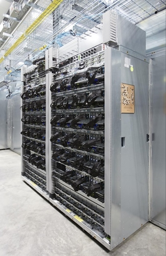 Server racks with TPUs used in the AlphaGo matches with Lee Sedol (Image source: Google Cloud Platform)