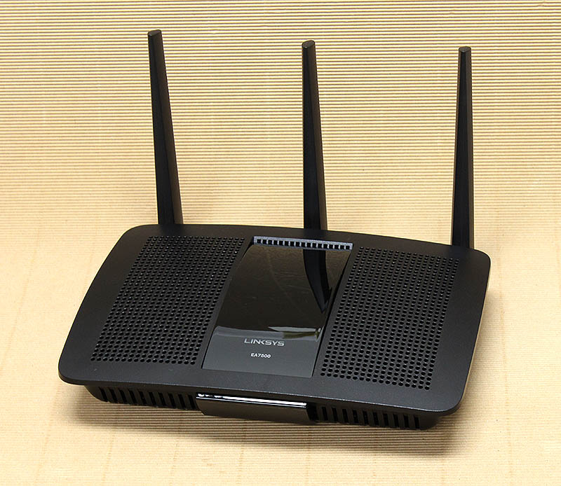 The Linksys EA7500 router looks just like the EA8500 router, but with one less external antenna.