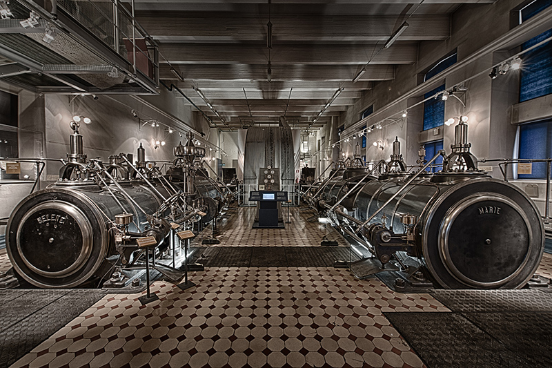 Steam engines like the one here were bulky, inefficient, and required many people to operate. (Image source: Tortured Mind Photography)
