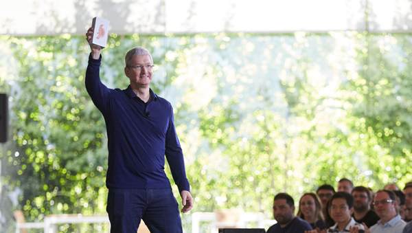 Tim Cook holding the billionth iPhone sold at an Apple employee meeting in Cupertino this morning.