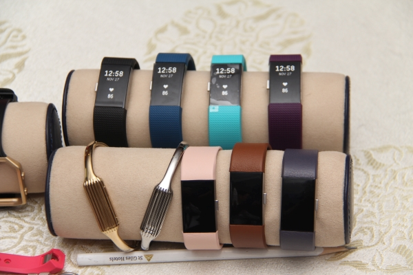 A closer look at the black, blue, plum and teal bands of the Charge 2 on the top row, and the leather bands in blush pink, brown and indigo. The two bangles for the Flex 2 are here as well.