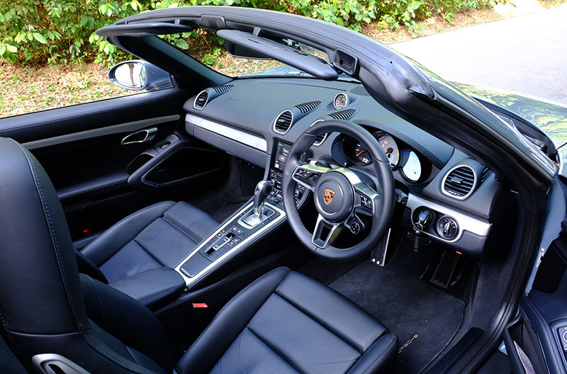The cabin is sporty and stylish, though, like other Porsches, suffers from having far too many buttons.