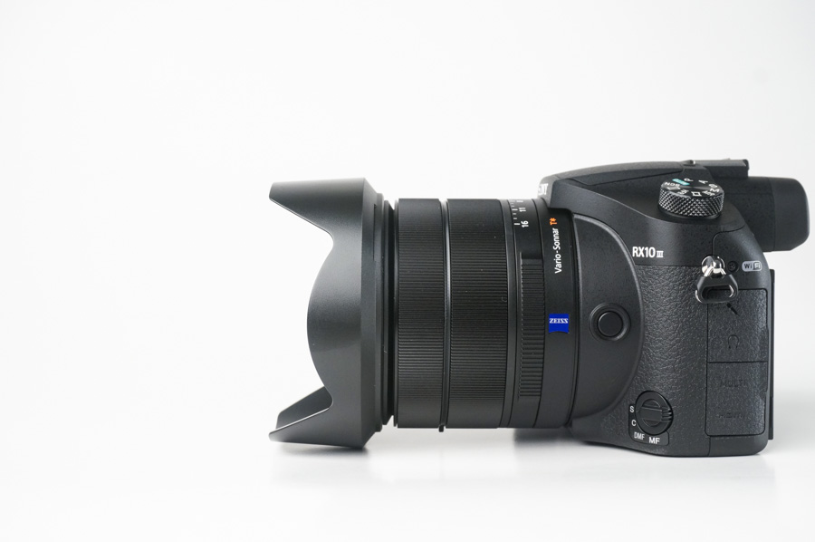 The lens retracts into the body itself, making it fairly compact for travel.