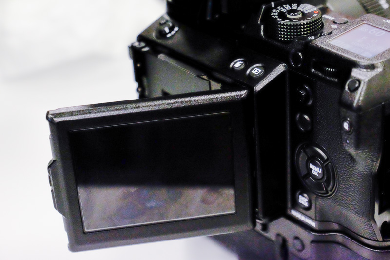 The EVF tilts to the side and up and down so you can use it even in portrait position.
