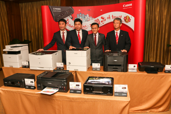 From L-R: Toshiaki Nomura, Assistant Director of Regional Business Imaging Solutions Division, Canon Singapore Pte. Ltd.; Jeffrey Kung, Assistant Director of Consumer Imaging and Information (CII), Canon Marketing (Malaysia) Sdn. Bhd.; Andrew Koh, President and Chief Executive Officer of Canon Marketing (Malaysia) Sdn. Bhd.; and Satoru Takeda, Senior Director and General Manager, Consumer Imaging and Information (CII) Group, Canon Singapore Pte. Ltd.