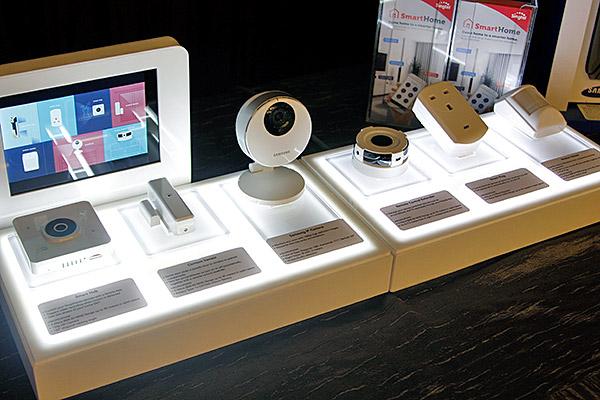 From left: Singtel Smart Hub, contact sensor, Samsung 1080p IP camera, IR remote control extender, smart plug, and motion sensor.