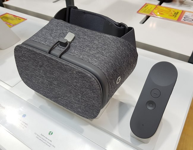 Google's own take of a comfortable and affordable VR headset that's compatible with phones designed with the compatibility of this device in mind. Also seen here is its accompanying controller.