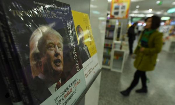 Wary of Trump's less than ideal view towards China, the country threatens to impair sales of key US goods, such as iPhones and U.S. cars in the country. <br> Image source: The Guardian