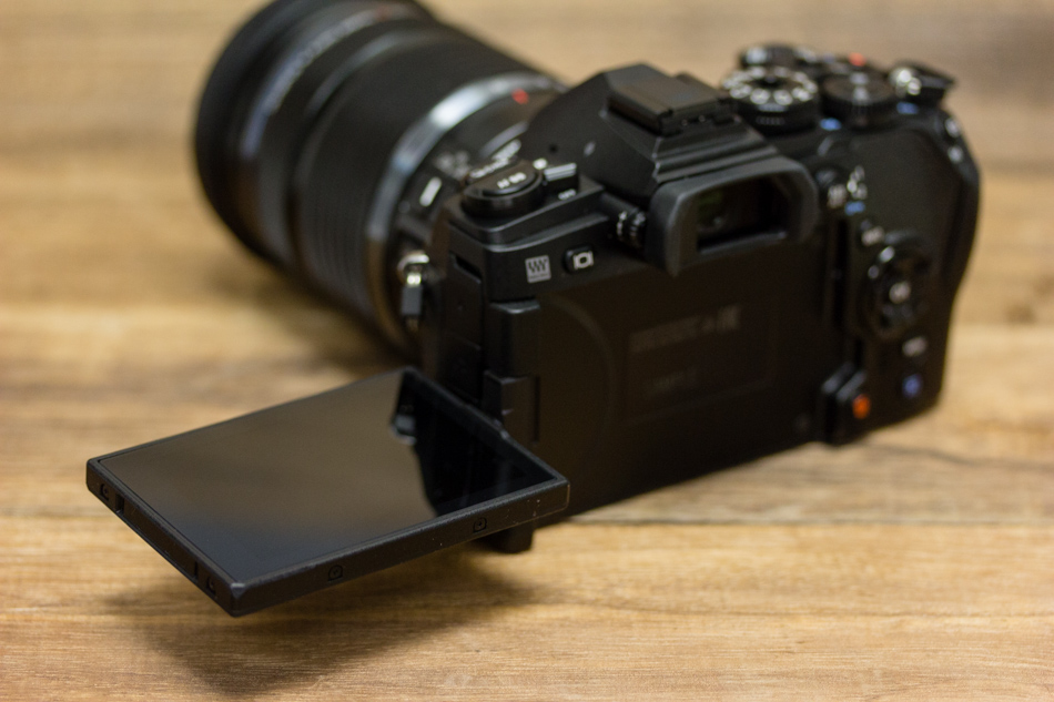 The E-M1 Mark II's screen swivels fully around, the E-M1's could only tilt up and down.
