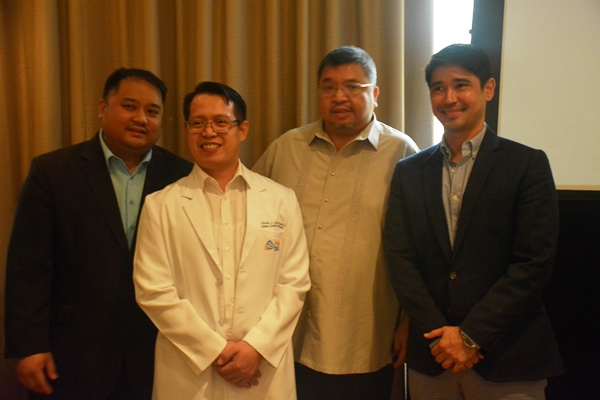 Ayala Healthcare Holdings, Inc.'s Medical Director, Michael Santos, MD (second from the left) with ADB Principal Health Specialist for Sustainable Development and Climate Change Department, Eduardo P. Banzon (middle), and GE Healthcare Philippines Country Manager, Ivan Alexi R. Arota (right)
