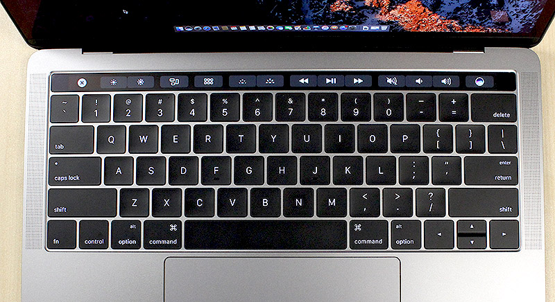 The Touch Bar sits above the keyboard and replaces the traditional function and media shortcut keys.