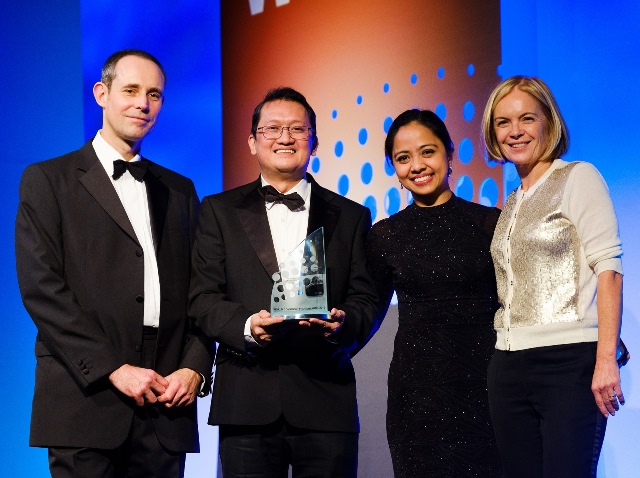Receiving the award on behalf of Smart are PLDT Global's Hoyle Raul Disuanco and Joanna Uson (center). Flanking them are Total Telecom's Managing Director, Rob Chambers, and Journalist, Mariella Frostrup.