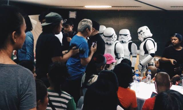 Stormtroopers giving away gifts, food, and Globe's wonderful surprises for the children.