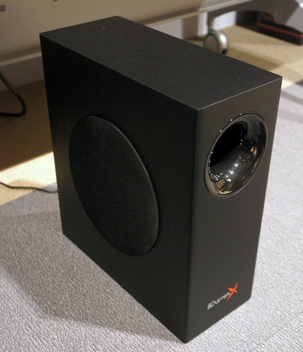 To reduce turbulence, a port tube with dual flares is built into the slim subwoofer. This helps it produce deep and dynamic bass despite its petite size.