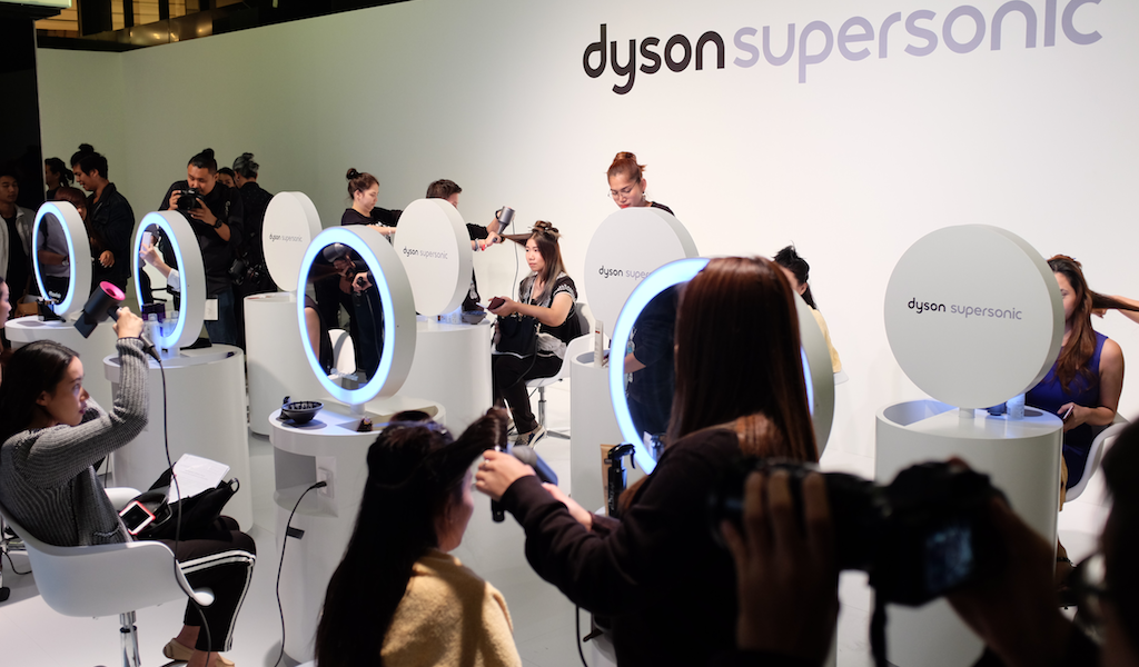 A pop-up salon where attendees were given the opportunity to have their hair styled with the Supersonic.