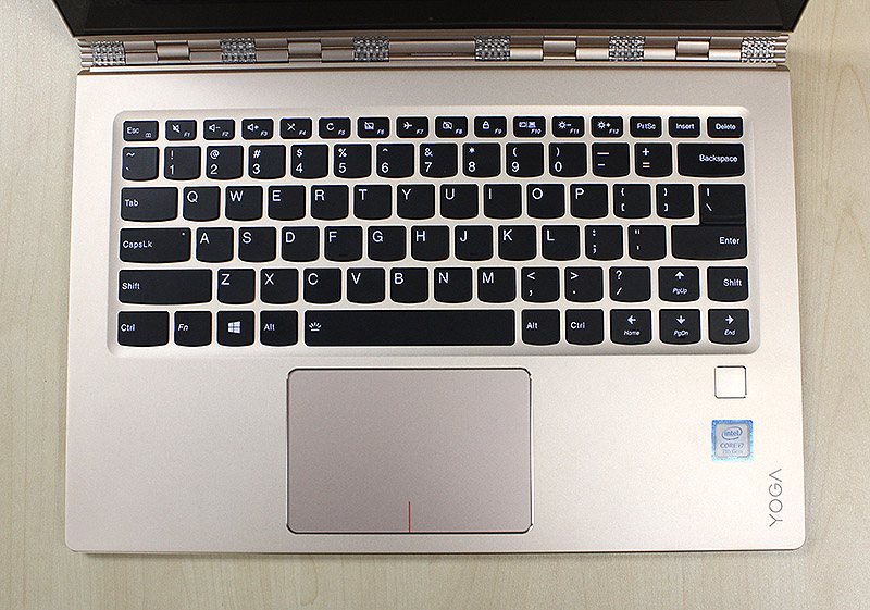 "The keyboard is well-sized and tactile, but the position and size of the right ""Shift"" key is poor and frustrating. Note also the fingerprint reader to the right of the trackpad."