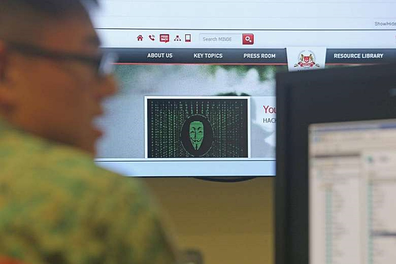"The personal details of 850 national servicemen and staff at the Ministry of Defence (Mindef) were stolen in what Mindef has described as a""targeted and carefully planned"" cyber attack. (Image source: The Straits Times)"